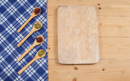 Tablecloth, wooden spoon, cutboard on wood Stock Image