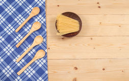Tablecloth, wooden spoon, on wood Royalty Free Stock Photos