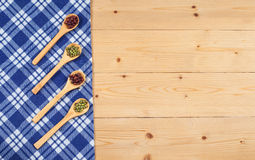 Tablecloth, wooden spoon, on wood Stock Photos