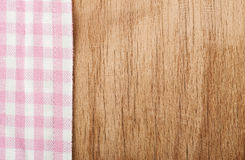 Tablecloth and wooden table Royalty Free Stock Photo