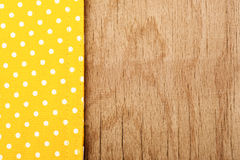 Tablecloth and wooden table background Stock Photography
