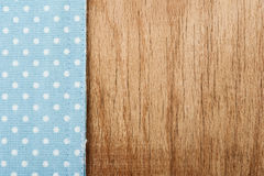 Tablecloth and wooden table background Stock Photo