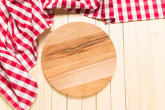 Tablecloth on wooden table Royalty Free Stock Photos