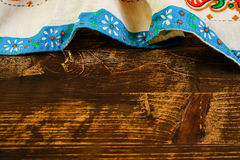 Tablecloth on wooden table, top view. Royalty Free Stock Images