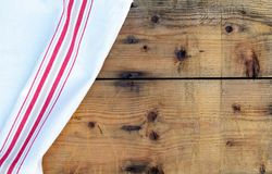 Tablecloth on wooden tabletop. Red and white tablecloth on rustic wooden background Stock Images