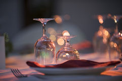 Tableclothes. Crystal glasses and dishes on a table Stock Images
