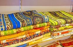 Tableclothes and covers in Antalya market. The a stacks of folded tableclothes, decorated with colored ornaments, Old Bazaar, Antalya, Turkey Royalty Free Stock Photography