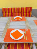 Tableclothes at a teak table. In the garden Stock Photos