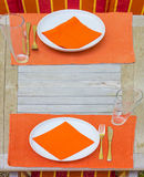 Tableclothes at a teak table Royalty Free Stock Photo