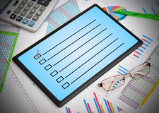 Tablen with checklist Stock Photo