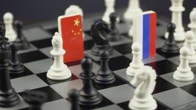 Tablero de ajedrez con las banderas de países metrajes