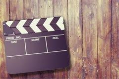 Tablero de chapaleta de la película en fondo de madera Foto de archivo libre de regalías
