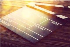 Tablero de chapaleta de la película en fondo de madera Fotos de archivo libres de regalías