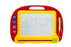 Tablero de dibujo borrable con el autismo de la palabra Fotos de archivo