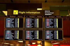 Tablero de la información del vuelo: Aeropuerto de Singapur Changi Fotos de archivo libres de regalías