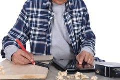 Tablero de la marca del carpintero Fotografía de archivo