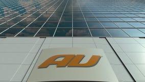 Tablero de la señalización con el logotipo móvil de la compañía telefónica del au Fachada moderna del edificio de oficinas Repres Fotografía de archivo