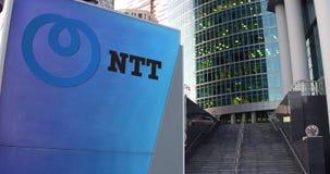 Tablero de la señalización de la calle con Nipón Telegraph y logotipo del NTT de Telephone Corporation Fotos de archivo
