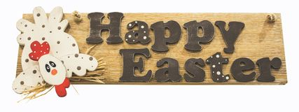 Tablero de madera con el saludo: pascua feliz aislada en blanco Imagen de archivo libre de regalías