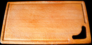 Tablero de madera para cortar Imagen de archivo