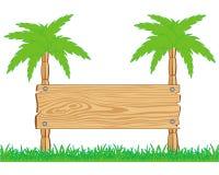 Tablero de madera y palmas Foto de archivo