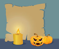 Tablero de papel de Halloween con una vela imagen de archivo