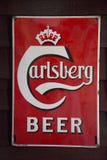 Tablero de publicidad antiguo de Carlsberg imagen de archivo libre de regalías