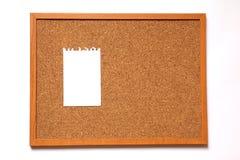 Tablero del corcho con la nota de papel Imágenes de archivo libres de regalías