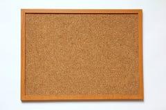 Tablero del corcho en el fondo blanco Fotografía de archivo libre de regalías