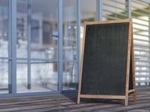 Tablero en blanco del menú en la acera Imagen de archivo libre de regalías