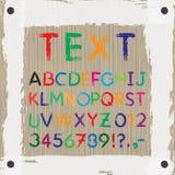 Tablero para el texto y las imágenes fuente Alfabeto Imagen de archivo