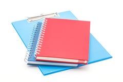 Tablero y cuadernos azules Fotografía de archivo