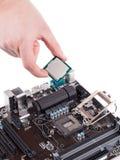 Tablero y microchip electrónicos Fotos de archivo libres de regalías