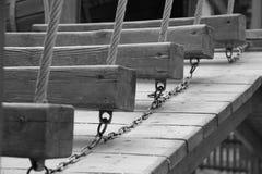 Tableros de madera en el parque Foto de archivo libre de regalías