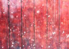 Tableros de madera y luces del bokeh del brillo con nieve Fotos de archivo libres de regalías