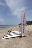 Tableros de paleta y muestra de la bandera en la playa Fotos de archivo libres de regalías