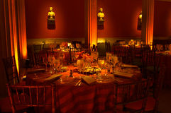 Tables. At wedding reception with a red/orange warm ambiance Stock Photos