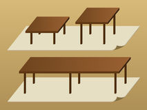 Tables. Simple wooden tables on the carpet Stock Photo