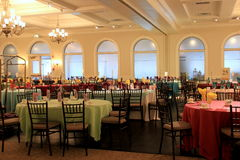 Tables being set for the Easter holiday festivities in the ballroom, Glen Sanders Mansion, Scotia, New York, 2017. Beautiful image of tables being set for Easter Stock Photos