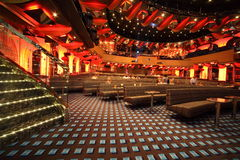 Tables in big illuminated hall of Costa Deliziosa Stock Photo