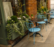 Tables and blue chairs outside. The restaurant or cafe Royalty Free Stock Image