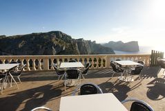Tables of cafe at sunset on Cap de Formentor - beautiful coast of Majorca, Spain - Europe. Tables of cafe at sunset on Cap de Formentor - beautiful coast of Royalty Free Stock Photo