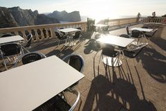Tables of cafe at sunset on Cap de Formentor - beautiful coast of Majorca, Spain - Europe. Tables of cafe at sunset on Cap de Formentor - beautiful coast of Royalty Free Stock Image