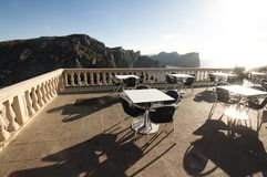 Tables of cafe at sunset on Cap de Formentor - beautiful coast of Majorca, Spain - Europe. Tables of cafe at sunset on Cap de Formentor - beautiful coast of Stock Image