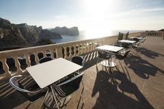 Tables of cafe at sunset on Cap de Formentor - beautiful coast of Majorca, Spain - Europe. Tables of cafe at sunset on Cap de Formentor - beautiful coast of Stock Images