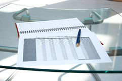 Tables, calendar, pen at office. Tables, calendar, pen on a glass table at office Royalty Free Stock Images