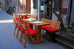 Tables and chairs. Outside the bar at afternoon Stock Image