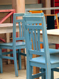 Tables and chairs. Colourful wooden tables and chairs in a restaurant Royalty Free Stock Image