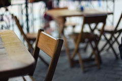 Tables and chairs in the bar at low depth of field Royalty Free Stock Photo
