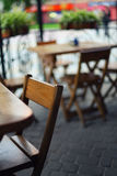 Tables and chairs in the bar at shallow depth of field Stock Photo